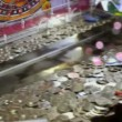 Play machine with many coins on moving tray inside, closeup view — Stock Video