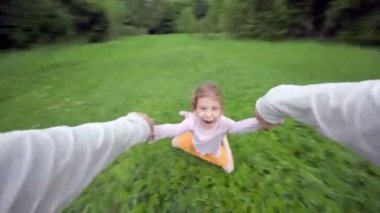 Hand holds little girl which flies above grass — Wideo stockowe