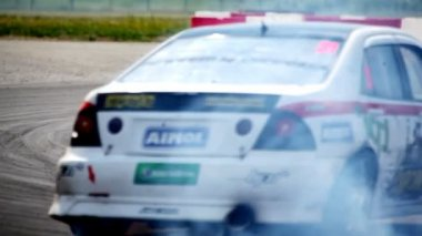 Racing cars enter into closeup turn on championship on drift — Stock Video