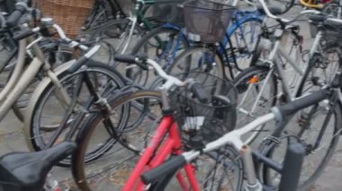 Many bicycles with baskets on parking, closeup view in motion — Stock Video