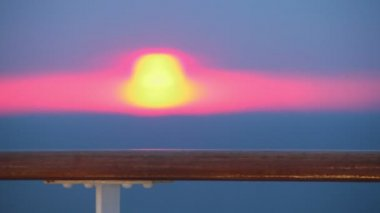 Sunset and handrail at deck of ship which sways on sea waves — Stock Video