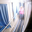 Stock Video: People go in corridor of compartment wagon, time lapse