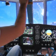 Stock Video: Pilot operates helicopter simulator during take-off