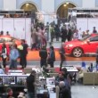 Two red new cars stand at exhibition VOLVO - Week of fashion — Stockvideo