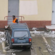 Guest worker cleans snow on parking for cars — Stock Video