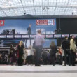 Vídeo Stock: Visitors walk in hall at exhibition on VOLVO - Week of fashion