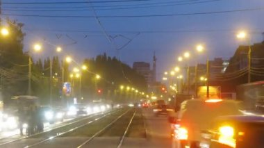 Trams go in middle of highway among stream of cars — Stock Video