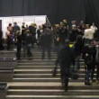 Stock video: People walk behind backstage on VOLVO - Week of fashion