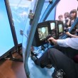 Pilot operates helicopter simulator on International exhibition — Stock Video