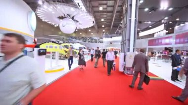Visitors go along helicopter exposed on International exhibition — Stock Video