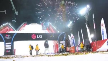 Light is shone after 18th stage of World Cup on snowboard — Stock Video