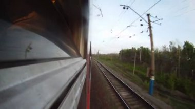 Train goes along forest belt and rural areas in the afternoon — Stock Video
