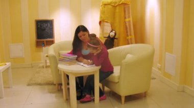 Mother with daughter read book in in playroom, time lapse — Stock Video
