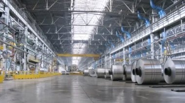Rolls of aluminum lie on floor in production workshop of plant — Stock Video