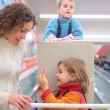 Mother with son and daughter in shop — Stock Photo #7424740
