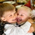 Children embrace on holiday in kindergarten — Stock Photo #7424909