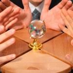 tre coppie di mani e globo di vetro su sgabello — Foto Stock #7425240
