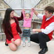 Young family in Moscow universal store — Stock Photo #7434598