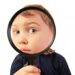 Child look through magnifier — Stock Photo #7443026