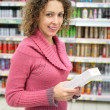 Girl with box in hands in store — Stock Photo #7445307