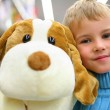 Boy with toy dog in shop — Stock Photo #7447509