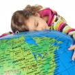 Little girl lies on big inflatable globe and embracing it, eyes — Stock Photo #7936886