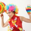 Young beauty woman in clown wig, flower garland and multicolored — Stock Photo #7937037