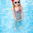 Little girl at swimming pool — Stock Photo #12655287