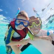 Father and son snorkeling — Stock Photo #12656007