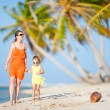 Mother and daughter on tropical vacation — Stock Photo #12656764