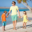 Royalty-Free Stock Photo: Father and kids on a beach