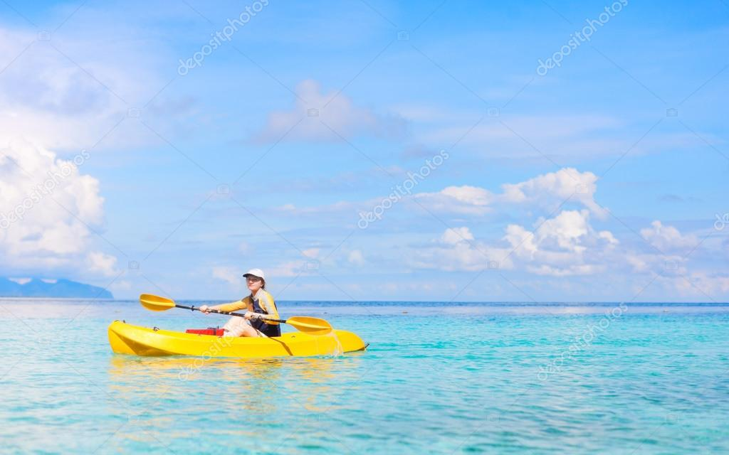 Young woman kayaking in a tropical lagoon — Stock Photo #12732820