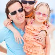 Father and kids at beach — Stock Photo
