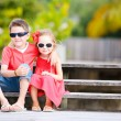 Brother and sister outdoors — Stock Photo #12956776