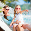 Mother and daughter relaxing in hammock — Stock Photo