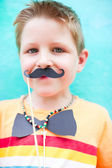 Cute boy with party accessories — Stock Photo