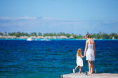 Mother and daughter at oceanfront — Stock Photo