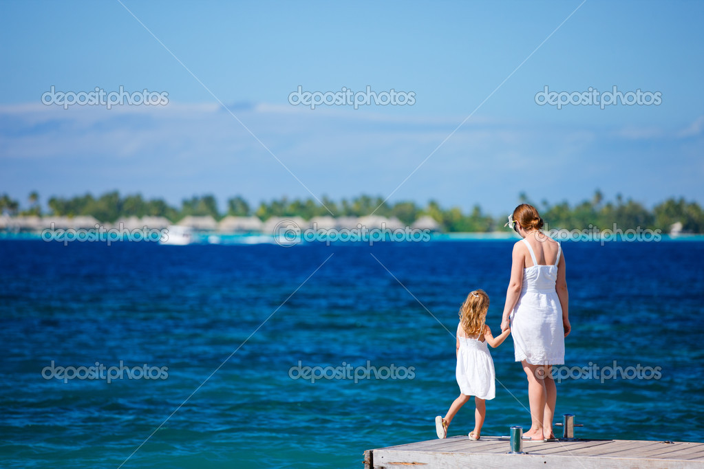 Mother and daughter enjoying beautiful ocean view  Foto Stock #12959298