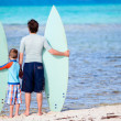 Stock Photo: Father and son with surfboards