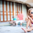 Little girl and her family on vacation — Stock Photo