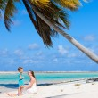 Royalty-Free Stock Photo: Mother and daughter on tropical beach