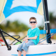 Cute boy at on catamaran — Stock Photo