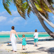 Mother and kids on a tropical beach — Foto de Stock