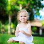 Sweet little girl outdoors — Stock Photo