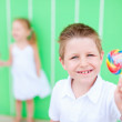 Boy with lollipop — Stock Photo #13548532