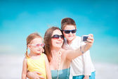 Family taking self portrait — Stock Photo