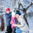 Family outdoors on winter day — Stok fotoğraf