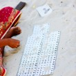 Woman playing bingo game - Stock Photo