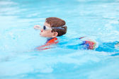 Boy at swimming pool — Stock Photo