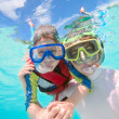Father and son snorkeling - Stock Photo